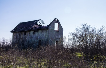 strongly: A strongly ruined house outskirts of the town.
