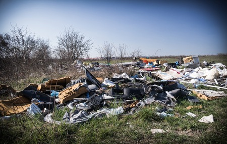 A huge illegal landfill, outskirts of town.