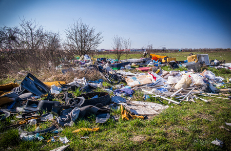illegal: A huge illegal landfill, outskirts of town.
