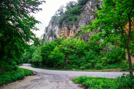 A road under the mountain, without cars