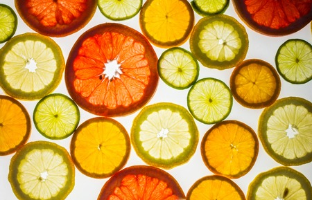 Background of some various colorful citrus slices.