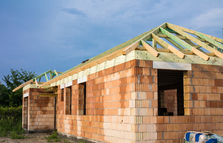 roof structure: Unfinished brick house with wooden roof structure. Stock Photo
