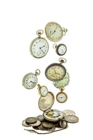 monete antiche: Old coins and soaring on a white background old pocket watch.