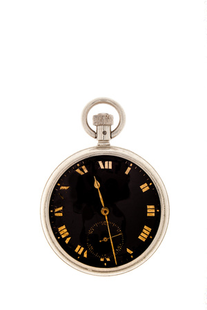 VVintage pocket watch with a black dial isolated on white background.