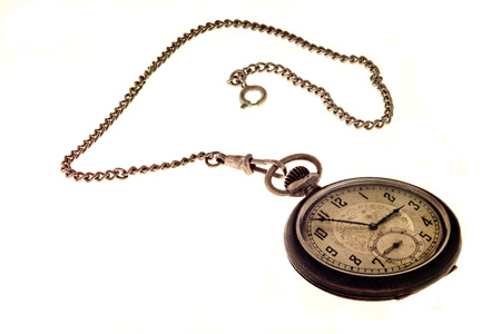 pendulum: Vintage antique pocket watch with chain isolated on a white background.