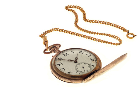 reloj de pendulo: Vintage antique pocket watch with chain isolated on a white background.