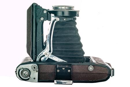 Vintage camera isolated on white background.