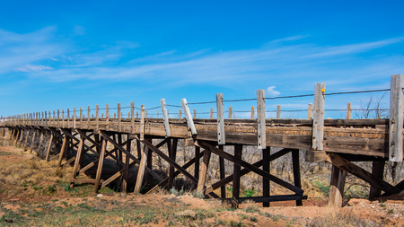 creosote: Route 66  One of four creosote-treated wood beam bridges on Route 66, near Endee, NM  Stock Photo