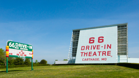 restlessness: CARTHAGE, MO USA - MAY 7, 2013  Historic 66 Drive-in Theatre and neon sign, on Route 66  National Register of Historic Places Editorial