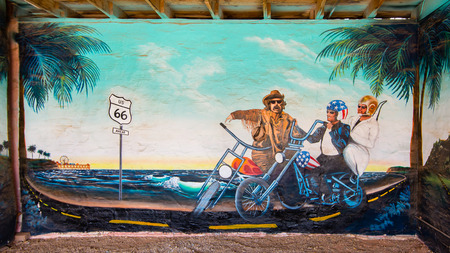counterculture: SELIGMAN, AZ USA - MAY 12, 2013   The Road of Art and Freedom  mural on Route 66, at the Aztec Motel  Phrases on mural   Chicago to Santa Monica  and  66 Belongs to us ALL   Editorial