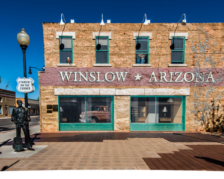 popularized: WINSLOW, AZ USA - MAY 12, 2013   Standin  On The Corner Park , on Route 66, pays homage to  Take It Easy , a song written by Jackson Browne and popularized by the rock group Eagles  Editorial