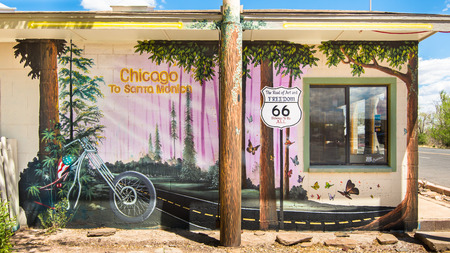 restlessness: SELIGMAN, AZ USA - MAY 12, 2013   The Road of Art and Freedom  mural on Route 66, at the Aztec Motel  Includes the phrases  Chicago to Santa Monica  and  66 Belongs to us ALL