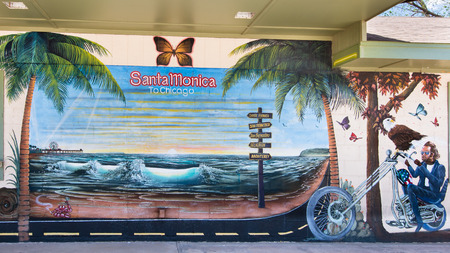 SELIGMAN, AZ USA - MAY 12, 2013   Santa Monica to Chicago   mural on Route 66, at the Aztec Motel