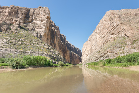 scenic drive: Rio Grande river reflection in Santa Elena Canyon, on the Ross Maxwell Scenic Drive, in Big Bend National Park, Texas. The river is the border between the USA and Mexico. Stock Photo