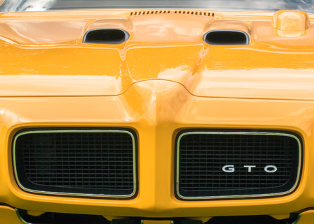 GROSSE POINTE SHORES, MIUSA - JUNE 21, 2015: A 1970 Pontiac GTO The Judge car named from a Sammy Davis, Jr. TV show Rowan  Martins Laugh-In comedy routine at the EyesOn Design car show. Редакционное