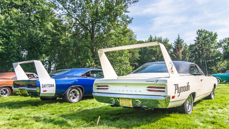 GROSSE POINTE SHORES, MIUSA - JUNE 21, 2015: A 1969 Dodge Daytona and 1970 Plymouth Superbird car at the EyesOn Design car show, held at the Edsel and Eleanor Ford House.