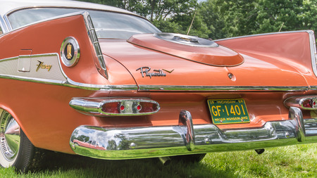 GROSSE POINTE SHORES, MIUSA - JUNE 21, 2015: A 1959 Plymouth Sport Fury car at the EyesOn Design car show, held at the Edsel and Eleanor Ford House.