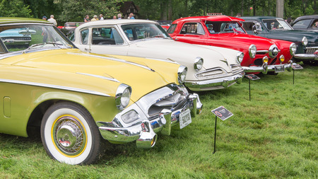 GROSSE POINTE SHORES, MIUSA - JUNE 21, 2015: Three Studebaker cars, 1955 President Speedster, 1953 Champion, and 1950 Champion Starlight at the EyesOn Design car show, held at the Edsel and Eleanor Ford House.