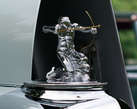 GROSSE POINTE SHORES, MIUSA - JUNE 21, 2015: A 1933 Pierce Arrow Archer hood ornament at the EyesOn Design car show, held at the Edsel and Eleanor Ford House.