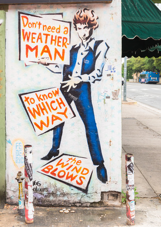counterculture: AUSTIN, TXUSA - APRIL 11, 2015: Mural depicts Bob Dylans lyrics: Dont need a weatherman to know which way the wind blows from the song Subterranean Homesick Blues, at the Hole in the Wall Restaurant.