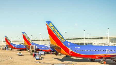 chicago: CHICAGO, ILUSA - April 11, 2015: Three Southwest airplanes parked at a Chicago Midway International Airport MDW terminal.