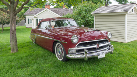 reminisce: DEARBORN, MIUSA - JUNE 20, 2015: A 1954 Hudson Hornet car at The Henry Ford THF Motor Muster, held at Greenfield Village. Editorial