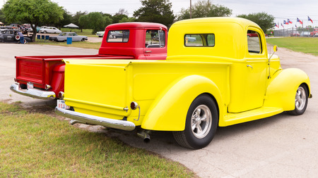 reminisce: AUSTIN, TXUSA - April 17, 2015: Two pickup trucks at the Lonestar Round Up, a celebration of 1963-and-earlier American hot rods and custom cars.