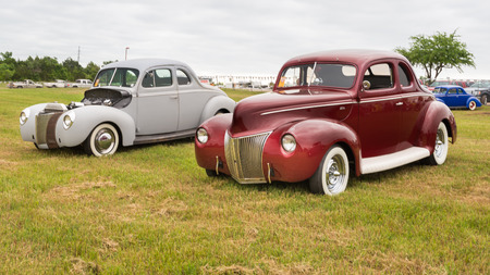 round rods: AUSTIN, TXUSA - April 17, 2015: Two Ford Coupe cars, 1939 and 1940 at the Lonestar Round Up, a celebration of 1963-and-earlier American hot rods and custom cars.