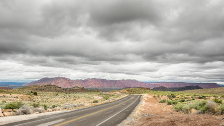 Low-hanging clouds over the Paiute Reservation on Old Highway 91, Nevada. Фото со стока