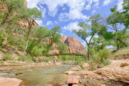 Emerald Pools Trail Bridge above the Virgin River, in Zion National Park, Utah. Фото со стока
