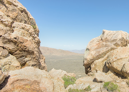 View through the Notch on Teutonia Peak Trail, in the Mojave National Preserve, California.