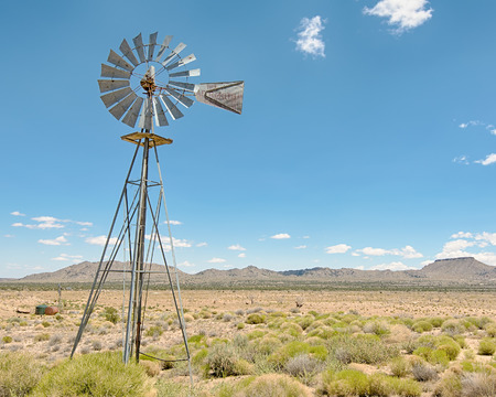 Windmill at Holliman Well on Black Canyon Road, in the Mojave National Preserve, California. Фото со стока