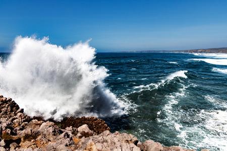 Waves against rough cliffs Stock fotó