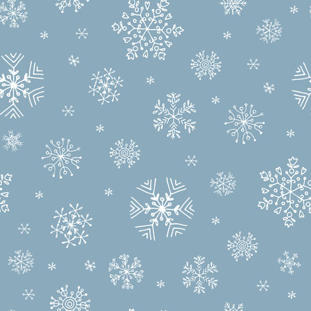 seamless pattern with white hand-drawn snowflakes on blue