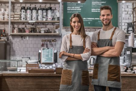 Portrait of successful business coffee shop owners