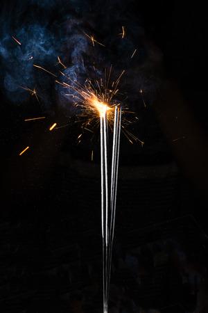 letter: Framework from sparkling fireworks on a black background