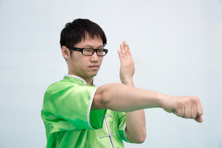 aikado: Man in green practice martial art in Chinese Martial Arts school.Kung fu