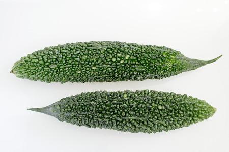 bitter: Green bitter gourd on white background