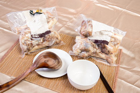packets: Chinese New Year dishes. Pig bone riser heating market to sell the ready-to-eat food packets Stock Photo