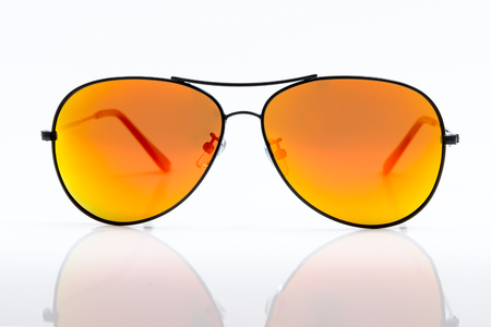 yellow eyes: Yellow sunglasses isolated on white background