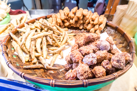 taiwanese: Taiwanese fried crispy sweet potato fries and deep fried popcorn chicken at food street night market Stock Photo