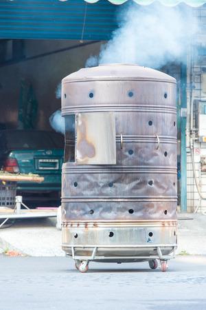 burning money: a stove of burning ghost money