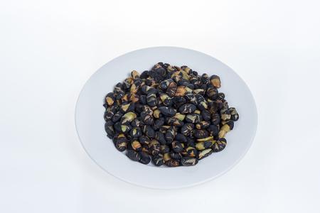 black beans: Black beans on white plate isolated on white background