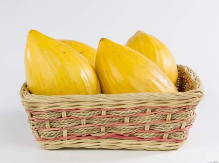 nautral: Canistel Egg Fruit in a bamboo basket Stock Photo