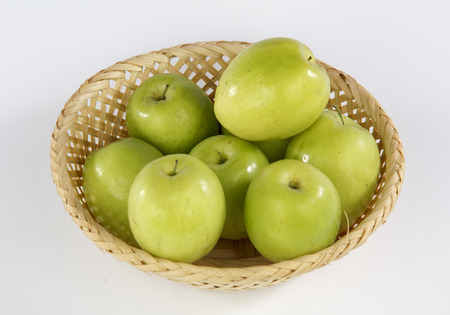 Jujube in a basket isolated on white background