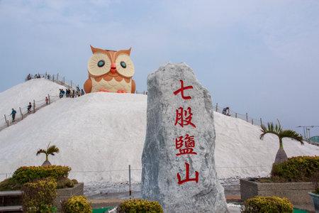 Qigu Salt Mountain, Taiwan- March 11, 2017: Salt Mountain and owl statue in Qigu Salt Mountain, Taiwan
