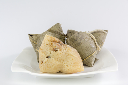 Chinese traditional food zongzi, glutenous rice dumplings, dragon boat festival food isolated on white background