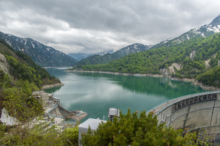 prefecture: The view of Kurobe Dam. The Kurobe Dam or Kuroyon Dam is a variable-radius arch dam on the Kurobe River in Toyama Prefecture, Japan