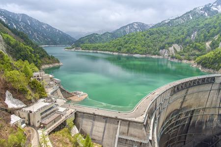 variable: The view of Kurobe Dam. The Kurobe Dam or Kuroyon Dam is a variable-radius arch dam on the Kurobe River in Toyama Prefecture, Japan