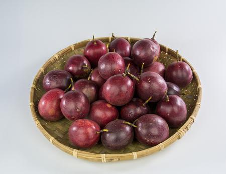 Passion fruit on bamboo basket isolated on white background